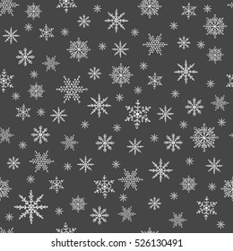 Pattern of white snowflakes on a black background. Snowflake vector pattern.