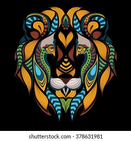 Patterned colored head of a lion. African / indian / totem / tattoo design. It may be used for design of a t-shirt, bag, postcard and poster.
