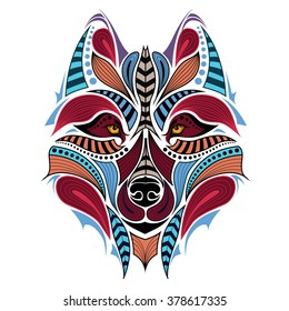 Patterned colored head of the wolf. African / indian / totem / tattoo design. It may be used for design of a t-shirt, bag, postcard and poster.