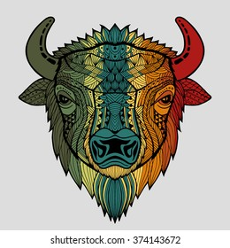 Patterned colorful head of a bull, bison. Abstract ethnic image of the head of a buffalo with an unusual ornament. Colorful rainbow decoration painted by hand. Series of animals in the ethnic style