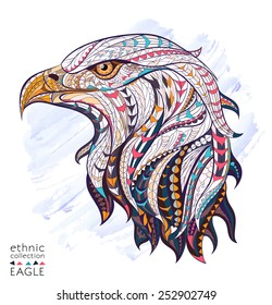 Patterned head of eagle on the grunge background. African / indian / totem / tattoo design. It may be used for design of a t-shirt, bag, postcard, a poster and so on.