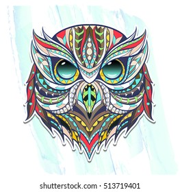 Patterned head owl on the grunge background. Tattoo design. It may be used for design of a t-shirt, bag, postcard, a poster, coloring book and so on.