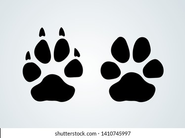 Paw prints and claw-free paw. Logo design. Vector illustration. Isolated on white background.