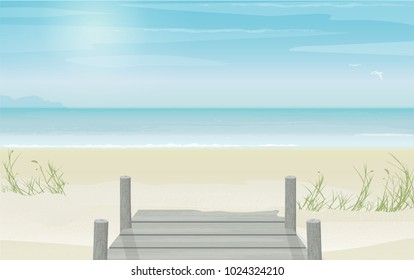 Peaceful and serene view of an empty beach landscape. Old pier and board walk entrance to the sandy beach.
