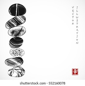 Pebble zen stones balance on white background. Traditional Japanese ink painting sumi-e. Contains hieroglyph - happiness.