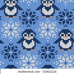 Penguin jacquard knitted seamless pattern. Winter blue background with cute animals. Northern style. Vector illustration.
