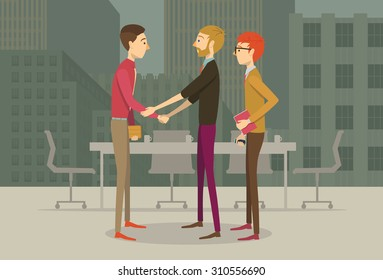 People in business casual outfits giving each other an agreement handshake