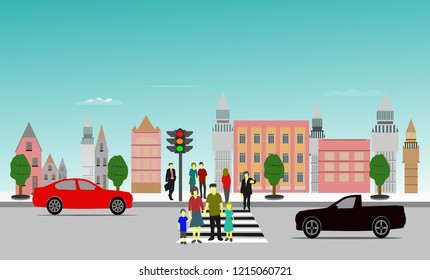 People crossing the crosswalk have stopped waiting,building and blue sky background