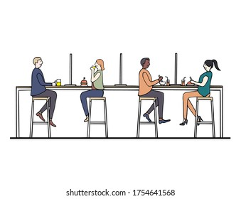 People dine and maintain social distancing with partition on counter bar at cafe to prevent and protect covid-19 coronavirus