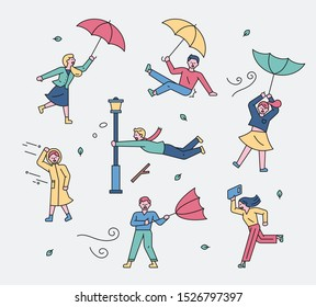 People flying with umbrellas in strong typhoon. flat design style minimal vector illustration
