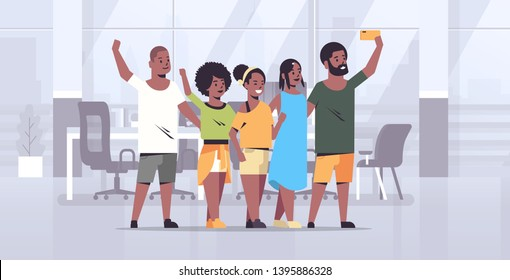 people group taking selfie photo on smartphone camera african american colleagues standing together modern office interior full length horizontal