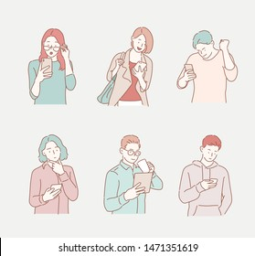 People are looking at their cell phones. Hand drawn style vector design illustrations.