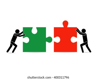 People move pieces of jigsaw puzzle for assembling