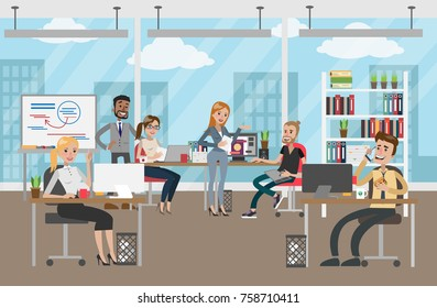 People at office working and discussing business project.