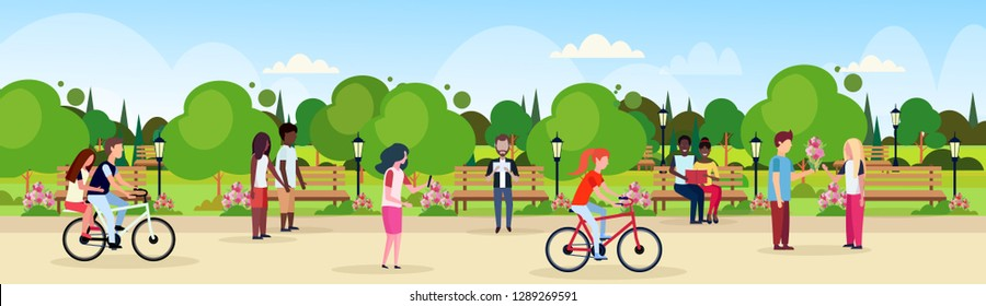 people riding bicycle walking city urban park celebrating happy valentines day holiday concept mix race men women lovers relaxing outdoor landscape background flat horizontal