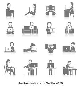 People working on computer sitting and laying black icons set isolated vector illustration