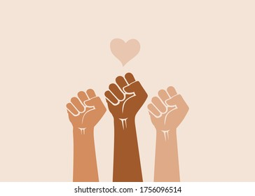 People's hands raised with clenched fists, isolated on a light background. Symbol of love and diversity. Human rights, feminism, equality and women's day concept. Black lives matter movement.