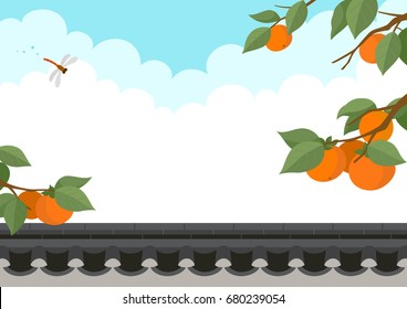 Persimmon tree and dragonfly with traditional Korean style stone wall fence.Autumn harvest holiday background