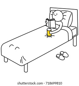 Person in bed reading a book with a pint of beer