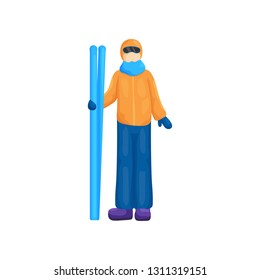 Person of unfamiliar gender, wearing ski suit, stands with skis in right hand