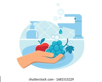 Person washing fresh fruit (apple and grape) in sink carefully with soap from dispenser to prevent coronavirus infection close up. Everyday hygiene essentials. Safety during COVID-19 pandemia.