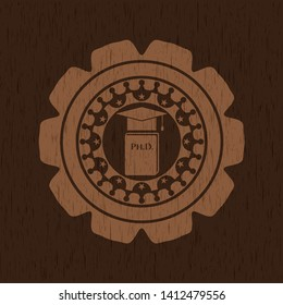 Phd thesis icon inside badge with wooden background