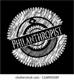 Philanthropist chalk emblem written on a blackboard