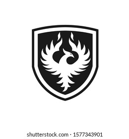 Phoenix with shield Vector Logo Template. Flying Fire Bird Illustration in a Shield