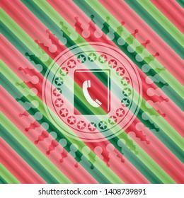 phonebook icon inside christmas badge background.
