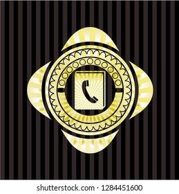 phonebook icon inside gold shiny badge