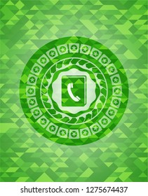 phonebook icon inside green emblem with mosaic ecological style background