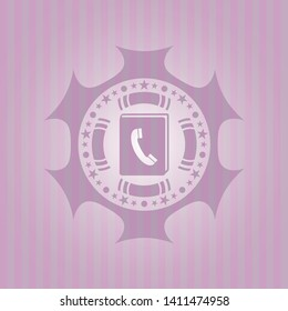 phonebook icon inside pink emblem. Vintage.