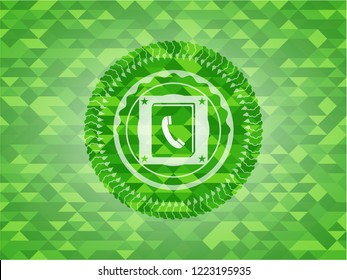 phonebook icon inside realistic green mosaic emblem