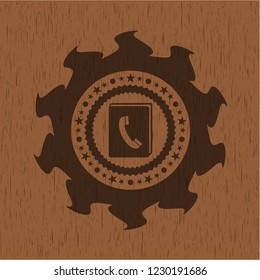 phonebook icon inside realistic wood emblem