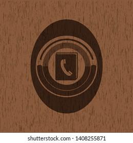 phonebook icon inside realistic wood emblem