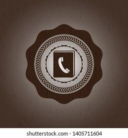 phonebook icon inside retro style wooden emblem