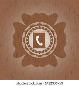 phonebook icon inside retro style wood emblem