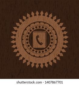 phonebook icon inside retro wood emblem