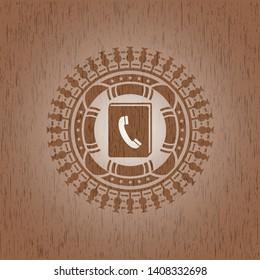 phonebook icon inside wood emblem