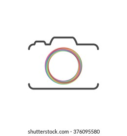 Photo camera silhouette with colorful circle
