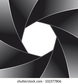Photo diaphragm open over white.