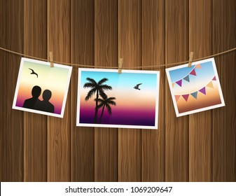 Photo frames fixed on the rope with clothespins on wood background. Vector.