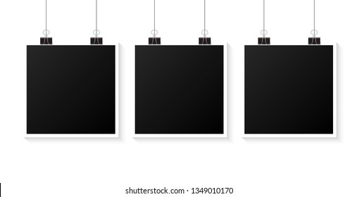 Photo frames hanging on a clip. Vector illustration