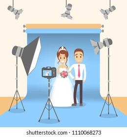 At photo studio with equipment and lightning. Marriage photoshoot.
