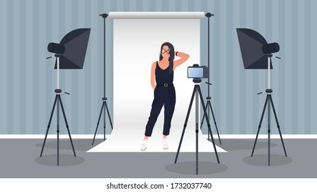 Photo Studio Vector. Girl posing to the camera. White canvas background on tripods. Camera on a tripod, softbox. Professional photo studio.