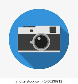 Photocamera flat icon with dropshadow, blue background. Vintage camera, photoalbum, image, picture. Flat design, simple, vector illustration.