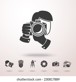 Photographer with camera icon in the air with shadow. With set of photographer stuff icons - shutter, camera, photos, shooting photographers, flash, tripod, spotlight. Vector