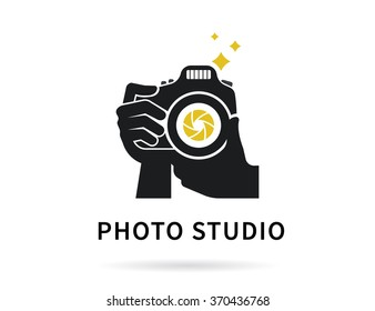 Photographer hands with camera icon or logo transparent template. Flat illustration of lens camera shooting macro image with golden flash and diaphragm
