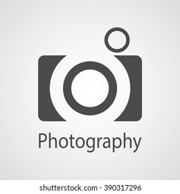 Photography icon with photo camera on white.