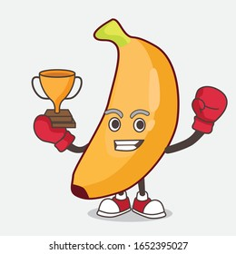 A picture of banana cartoon mascot character as Boxing winner of arcade game machine